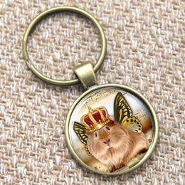 Pequenos animais de vidro on-line-12 pcs cobaia keyring, pequeno animal peludo keyring vidro foto borboleta asas jóias chaveiro