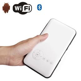 Wholesale Core Quard - Wholesale- 1500 lumens 2000:1 mini portable projector 4300mAH LI-PO 8GB Quard Core DLP Smart phone proyector with android4.4 WIFI bluetooth