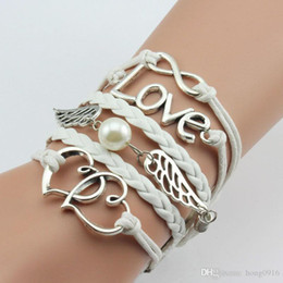 Wholesale Infinity White Pearl Bracelet - The New Hot explosion Fashion Womens Leather Weave Retro Multilayer Cute Infinity Love Heart Wings Charms Bracelet