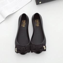 Chaussures variées en Ligne-nouveau 2017 joker poisson bouche sandales trou trou chaussures de plage, belles chaussures de gelée plat avec sandales bowknot femme, une variété de couleurs