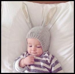 Niña bebé pascua online-Bebé conejo de Pascua Beanie sombrero de punto precioso conejito invierno cálido proteger orejas bebés niño niña sombrero venta al por mayor 2017 negro gris 0-12 meses