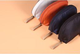 Paquete de bolsa de corea de las mujeres online-La bolsa de maquillaje de Corea del Sur está repleta de pequeñas bolsas de cosméticos para mujeres y de la mano para llevar una mini bolsa de cosméticos a prueba de agua