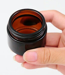 Wholesale Small Glass Jars Cosmetics - Cosmetic Custom 20g Amber small Glass Jars stash containers with black gold silver Covers wax cosmetic cream jarcontainer