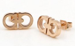 Wholesale gold letter d - New Korean version of the double D letter earrings female fashion titanium steel simple wild OL titanium steel earrings jewelry