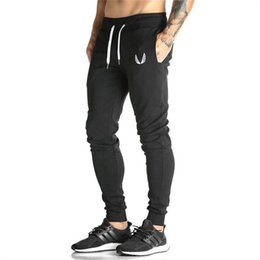 Wholesale Muscles Men Pants - 2017 sports fitness pants new men's loose breathable jogging training muscle exercise sports pants cotton stretch casual trousers
