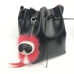Anguria rosso-vera pelliccia genuina Karl Lafayette Monster Bag Bug Punk Charm Pompon Fur Ball Bag Accessies di fascino cheap watermelon balls da palle di anguria fornitori