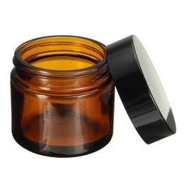 confezione di pelle nera Sconti 100 pz / lotto 60 ml Vuoto Vaso di Vetro Amber Pot Skin Care Cream Bottiglia Riutilizzabile Contenitore Cosmetico Strumento di Trucco Con Coperchio Nero Per L'imballaggio Da Viaggio
