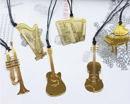 Wholesale Golden Books Wholesale - Bookzzicard Golden Metal Music Bookmarks Piano Guitar Trumpet Designs Book marks Korean Stationery Gifts Wedding Gifts ak128