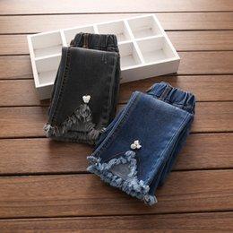 Wholesale Kids Bow Jeans - Girls jeans 2017 autumn new children hole tassel lace denim pants kids stereo bows cowboy trousers children all match trousers T3745