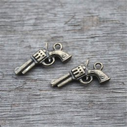 Wholesale Gun Charms Wholesale - 25pcs--Gun Charms,Antique Bronze 3D handguns Pistols Guns Charms Pendants 21x11mm