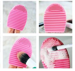 Novità Ricco colore Nuovo tipo di disegno a mano Brushegg in silicone Spazzola per la pulizia del trucco Uovo cheap types cleaning brushes da spazzole di pulizia dei tipi fornitori