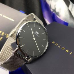 Просмотрам онлайн-Новый 32 мм Даниэль Веллингтон часы золото сторона черная пластина нержавеющая сталь Милан стиль ремешок кварцевый мода досуг дамы dw часы коробка relogio