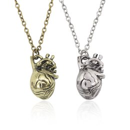 Wholesale Human Heart Halloween - Hot Vintage Healthy Heart Pendant Necklace Hollow Design Human organ Pendants Necklaces Men And Women Sweater Chain Necklaces Wholesale