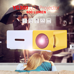 Wholesale Hot Video Game Player - Wholesale-Hot Sale YG300   YG310 LCD Projector 600LM Home Media Player MINI Projector Video Games TV Home Theat Support HDMI AV SD