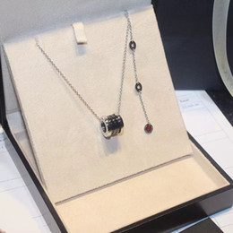 Wholesale Titanium Snake Pendant - The charity version of the red thread ceramic couple necklace titanium steel marble necklace with small red people anti - counterfeits