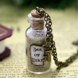 Wholesale Sparrow Key - 12pcs Jar of Dirt Necklace with Key Charm Pirates of the Caribbean Jack Sparrow Tia Dalma necklace in bronze