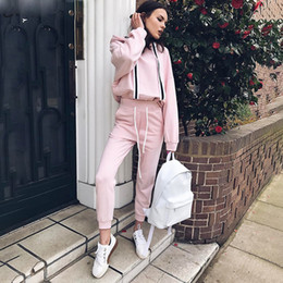 La raya lateral de la cinta rosa chándal mujeres 2 unidades Hoodies Jogger establece Casual de gran tamaño jerseys pantalones traje desde fabricantes