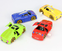 Wholesale Wind Car Toy - Chain rotation cartoon car wind-up toys Infants and young children toys toys chain will automatically open the door