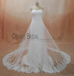 Wholesale Tulle Bridal Capes - 2017 Strapless Sheath Wedding Dresses with Pleated Bodice Appliques Beaded Lace Cape Floor Length Court Train White Bridal Gowns