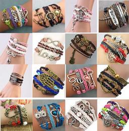 Styles de bracelets à l'infini en Ligne-Vente chaude Infinity Bracelets Charme Bracelet 16 styles de mode Bracelets En Cuir BRICOLAGE Antique Croix Bracelets MultilayerHand Décoratif 30 pcs