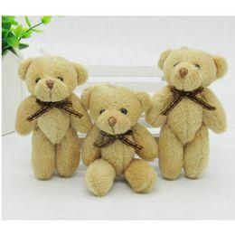 Lazo de oso de peluche online-Kawaii pequeño conjunto osos de peluche rellenos de felpa con pajarita 8cm juguete osito Teddy Bear osos de peluche juguetes de boda 20 unids / lote 047