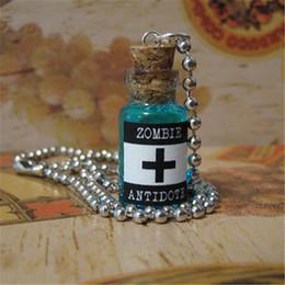 2019 frasco de vidrio de plata collar 12pcs / lot Walking Dead Virus Antivirus Cure Collar Zombie Antidote Glass Vial Colgante tono plateado frasco de vidrio de plata collar baratos