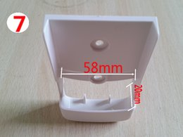 Wholesale Tv Wall Mounts Free Shipping - Wholesale- Free shipping ! 1pcs New (7) TV DVD Air Conditioner Wall Mount Remote Control Holder Wall Mounted 58mm*20mm (2.28in*0.79in)