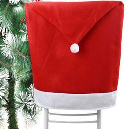 Оптовая продажа-1 шт. Рождество украшения Санта красная шляпа стул задняя крышка обеденный стол партия большой мешок чулок Санта-Клауса рождественские подарки cheap xmas party hats от Поставщики рождественские шляпы