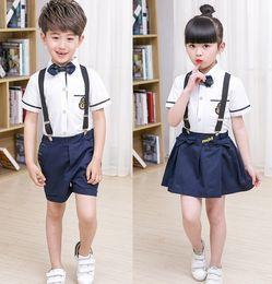 Wholesale Girls Tied Skirt - 2017 New Kids School Uniform Dress Set 2PCS Set Bow Tie Girl White T-shirt + Suspender Skirt Boys White Shirts+Suspender Short Pants B4603