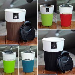 Wholesale Coffee Mug Sleeve - 8oz Capacity Ceramic Starbucks Coffee Mug with Push Lid and Silicone Sleeve