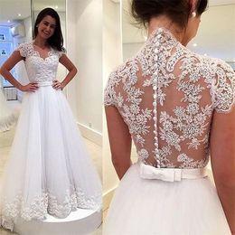 Vestidos de novia de encaje de país modesto Una línea de manga de la ilusión blusa botón cubierto Vestidos de novia de tul con Faja Vestidos De Noiva desde fabricantes