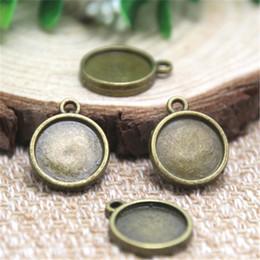 Wholesale Bronze Round Charms - 25pcs Antique Tibetan bronze Tone round double sided Glass Cabochon settings charm pendants fit 12mm glass dome