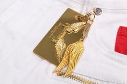Wholesale Trousers Wing - Fashion accessories brand LOGO key chain belt buckle golden wings Men and women trousers pendant accessories decorative items