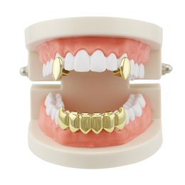 2017 préféré des femmes 4 couleurs Hommes Femmes Vampire Fangs Dents Hip Hop Grillz Top Bottom Dental Grills Set Copper Body Jewelry Party Gifts Rapper Hiphopman Favorite préféré des femmes promotion