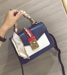 Wholesale Outlet Handbags - outlet brand package, fashion scarves, portable small bag street shot, the same type of hit color handbags, elegant stitching leather ha