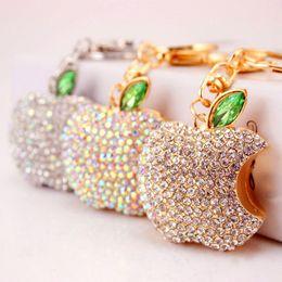 Wholesale Cross Christmas Led Lights - Creative new car keychain filled with Christmas apple key chain bag pendant