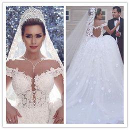 Vestido De Novia 2017 Vogue Arabian Design Vestidos De Novia De Hombro Apliques De Cuentas Sheer Volver Boda Vestido De Novia desde fabricantes
