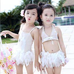 Argentina Los niños del bebé traje de baño suave y cómodo patrón de cisne blanco niñas falda de natación playa de una sola pieza de baño de los niños con gorra Suministro