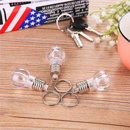 Wholesale Light Bulb Key Chains - LED Flashlight Light Bulb Keychain Lamp Torch bag key chains Crystal Car Key Chain Women Key Holder