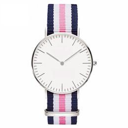 Wholesale Прохладный творческий кварцевые часы Женева ультра тонкий серебряный оболочки личности открытый мода Женева нейлон ткань красочные случайные часы