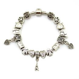 Fascino di serpente tibetano online-Bracciale con catena serpente vintage per uomo europeo Peace and Love Bracciale con cuore in argento tibetano e charms torre