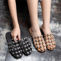 Wholesale ladies shoes size 44 - Cheap Ladies Plus Size 33-44 Street Fashion Scuffs Studded Rivets Slippers Women Casual Shoes Summer Slip On Slides Black White Flat Mules
