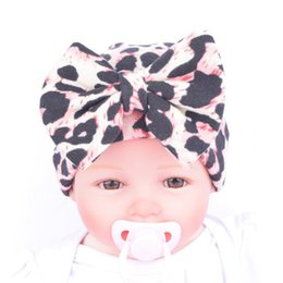 Wholesale Knitted Leopard Hats - Maternity Fashion Baby girl hat knit Newborn bow cap 2016 leopard Quality Boutique Accessories 0-3month Winter European Autumn wholesale