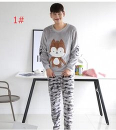 Wholesale Autumn couple pajamas men and women cartoon camouflage flannel home service couples pajamas suit