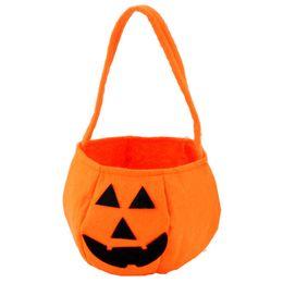 Nuevos suministros para fiestas de Halloween Telas no tejidas Bolsas de calabaza Accesorios de Halloween Niños Niños Juguetes Bolsa de dulces venta caliente desde fabricantes