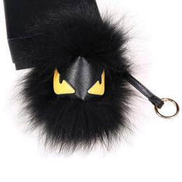 "Wholesale Real Fur Handbags - 18cm 7"" Black Real raccoon Fur Monster yellow eyes Bug bag Charm Ball Pompom Keychain Holder Backpack Tassel Pendant Handbag"