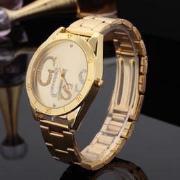 Bandes d'or femmes en Ligne-Cristal unisexe de style de marque de mode féminine montre-bracelet à quartz GS03 de montre en acier de bande en métal d'or