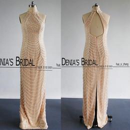 2016 vestido de noche de lujo del halter con cuentas vaina barrido tren Keyhole espalda Real Feather vestidos de baile de noche desde fabricantes