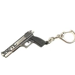 Wholesale gun metal game - Wholesale 50pcs lot Game Gun Model Key Chain Metal Alloy Key Rings Key Holders Size 6cm Blister Card Package