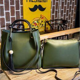 Wholesale Tow Soft - Feeling Textured leather handbag shoulder diagonal bag casual retro fringed bucket bag handbag PIP package tow piece suit